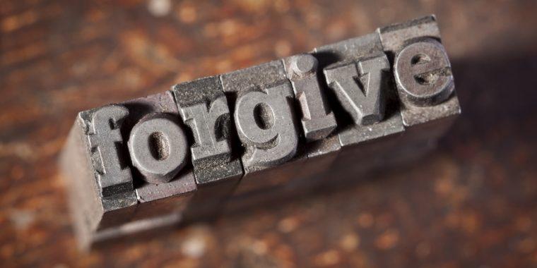FORGIVE Written In Old Metal Typeset